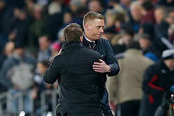 Swansea City Head Coach Garry Monk looks dejected as he hugs Liverpool Manager Brendan Rodgers after Liverpool win the match 0-1 - Photo mandatory by-line: Rogan Thomson/JMP - 07966 386802 - 16/03/2015 - SPORT - FOOTBALL - Swansea, Wales — Liberty Stadium - Swansea City v Liverpool - Barclays Premier League.