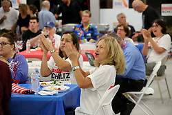 Democratic supporter Ver Santos Conclaves cheers as she watches election results come in at the campaign's headquarters in Davie, Fla., for Congresswoman Debbie Wasserman Schultz on Tuesday, Nov. 6, 2018. Photo by Mike Stocker/Sun Sentinel/TNS/ABACAPRESS.COM
