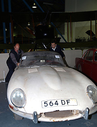 Two Bonham employees put a 1961 Jaguar E-Type 'flat floor' into place in preparation for Monday April 29, 2013 car auction at the RAF Museum in Hendon, London.  The car which was in a barn for the last 30 years is expected to fetch £25,000 to 30,000 in the auction, photo taken Sunday April 28, 2013. Photo by: Max Nash / i-Images