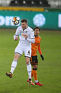 Alfie Mawson of Swansea city heads the ball. The Emirates FA Cup, 3rd round replay match, Swansea city v Wolverhampton Wanderers at the Liberty Stadium in Swansea, South Wales on Wednesday 17th January 2018.<br /> pic by  Andrew Orchard, Andrew Orchard sports photography.