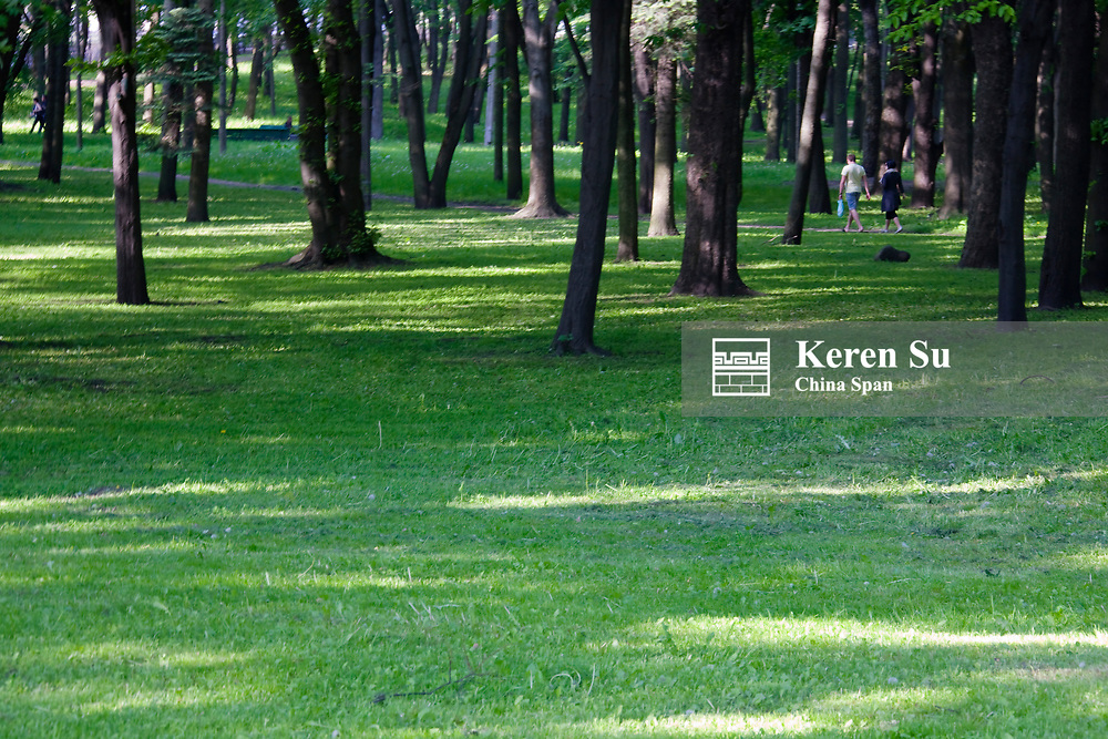 Park lined with trees, Minsk, Belarus