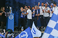 Tony Bloom gives medal to Brighton & Hove Albion winger Anthony Knockaert (11) during the Brighton & Hove Albion Football Club Promotion Parade at Brighton Seafront, Brighton, United Kingdom on 14 May 2017. Photo by Phil Duncan.