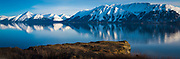 Mountains along the Turnagain Arm near Anchorage, Alaska.  Cook Inlet stretches 180 miles (290 km) from the Gulf of Alaska to Anchorage in south-central Alaska. Cook Inlet branches into the Knik Arm and Turnagain Arm at its northern end, almost surrounding Anchorage.
