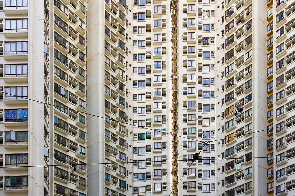 Close-up to a densely populated apartment buidling in Hong Kong, China