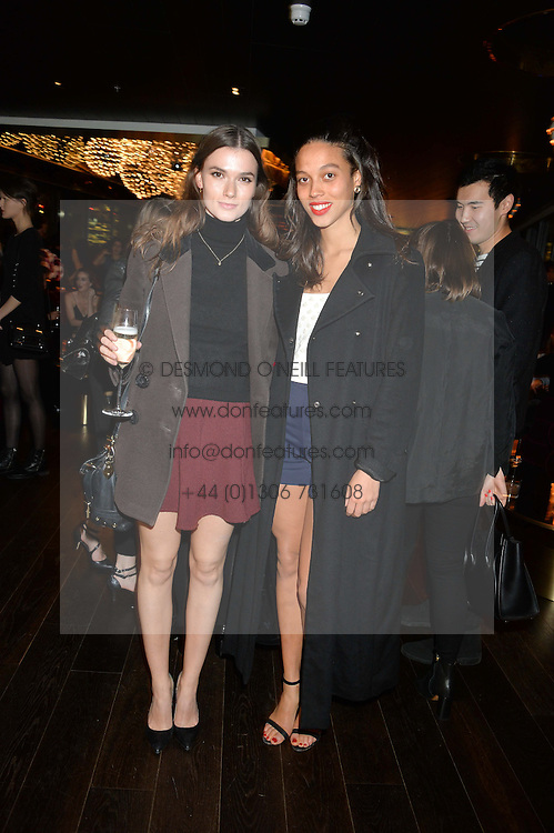 Left to right, HANNAH CASSIDY and ISIS DE SAMASA at the Launch Of Osman Yousefzada's 'The Collective' 4th edition with special guest collaborator Poppy Delevingne held in the Rumpus Room at The Mondrian Hotel, 19 Upper Ground, London SE1 on 24th November 2014, sponsored by Storm models and Beluga vodka.