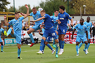 AFC Wimbledon striker Joe Pigott (39) winning header in a crowded penalty box during the EFL Sky Bet League 1 match between AFC Wimbledon and Coventry City at the Cherry Red Records Stadium, Kingston, England on 11 August 2018.