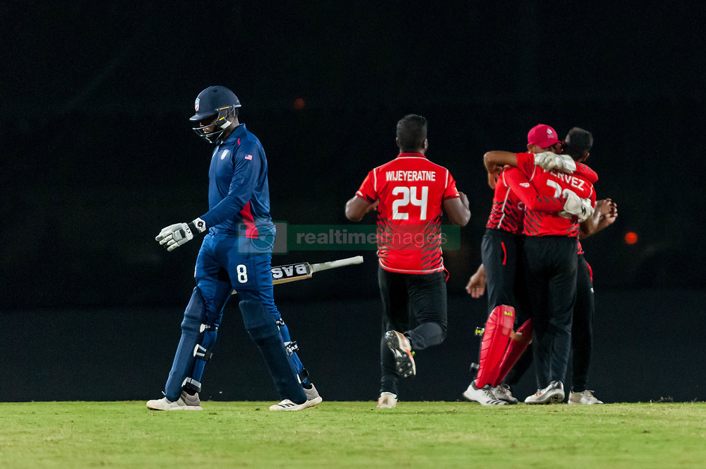 September 22, 2018 - Morrisville, North Carolina, US - Sept. 22, 2018 - Morrisville N.C., USA - Team Canada celebrates their Super Over win as Team USA STEVEN TAYLOR (8) walks off the field during the ICC World T20 America's ''A'' Qualifier cricket match between USA and Canada. Both teams played to a 140/8 tie with Canada winning the Super Over for the overall win. In addition to USA and Canada, the ICC World T20 America's ''A'' Qualifier also features Belize and Panama in the six-day tournament that ends Sept. 26. (Credit Image: © Timothy L. Hale/ZUMA Wire)