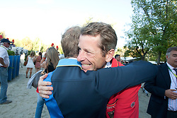 Bengtsson Rolf Goran (SWE) winner of the Gold medal congratulated by Carsten Otto Nagel (silver medal)<br /> Winner of the Gold medal FEI European Jumping Championship - Madrid 2011<br /> © Dirk Caremans