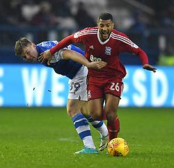Birmingham City's David Davis battles with Sheffield Wednesday's Jordan Thorniley