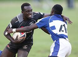 Bright Anditi (L) of Mwamba RFU challenges Maxwell of Mean Machine during their Kenya Cup Tournament at Railway Club In Nairobi, on 3rd December 2016. Mwamba won 51-8. Photo/Fredrick Onyango/www.pic-centre.com (KEN)