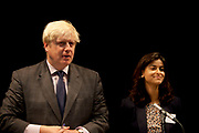 London, UK. Friday 19th October 2012. The Mayor of London, Boris Johnson answers questions with Munira Mirza, Deputy Mayor for Education and Culture at Pimlico Academy secondary school as he unveils ambitious plans to make London a world leader in education. The announcement coincides with the publication of the final report from the Mayor's Education Inquiry, which the Mayor commissioned to look at the challenges facing London's schools.