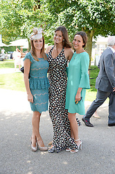 Left to right, NATALIE PINKHAM, LADY NATASHA RUFUS ISAACS and LAVINIA BRENNAN at the 3rd day of the 2013 Glorious Goodwood racing festival - Ladies day at Goodwood Racecourse, West Sussex on 1st August 2013.