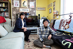 © Licensed to London News Pictures . 25/09/2018 . Bury , UK . North Korean refugee JIHYUN PARK (50) with her husband KWANG HYUN JOO (60) at their home in Bury . Jihyun was imprisoned , tortured and trafficked by the regime in North Korea before she managed to escape with the help of her husband . Photo credit : Joel Goodman/LNP