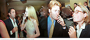 Charles Orchard and Lady Eloise Anson left. Smoking at a party. 1999<br /> © Copyright Photograph by Dafydd Jones 66 Stockwell Park Rd. London SW9 0DA  Tel 0171 733 0108