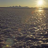 ANTARCTICA, Queen Maud Land. Midnight sun over wind-swept, bare-ice glacier near Fenris Mountains.