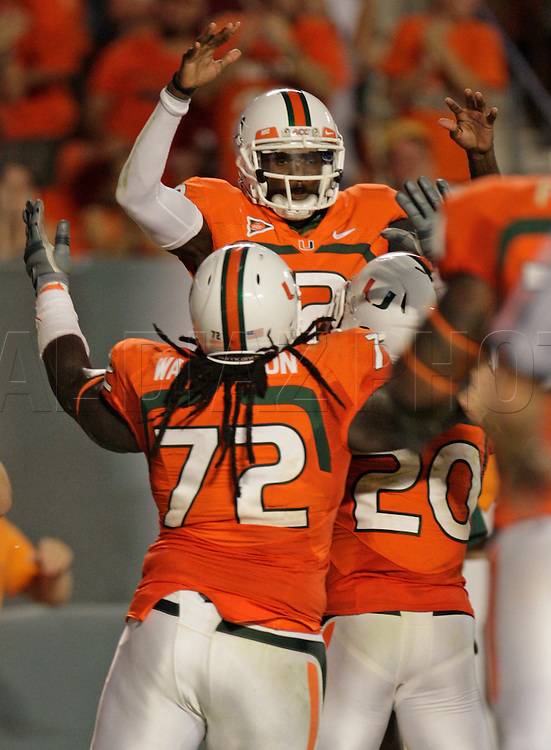 Miami's quarterback Jacory Harris celebrates with teammates after scoring a touchdown in the second quarter during the University of Miami vs Florida State University on Saturday October 9, 2010.