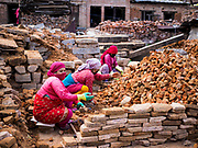 14 MARCH 2017 - BUNGAMATI, NEPAL: Women sort bricks in an ancient Hindu temple destroyed by an earthquake in Bungamati. Recovery seems to have barely begun nearly two years after the earthquake of 25 April 2015 that devastated Nepal. In some villages in the Kathmandu valley workers are working by hand to remove ruble and dig out destroyed buildings. About 9,000 people were killed and another 22,000 injured by the earthquake. The epicenter of the earthquake was east of the Gorka district.            PHOTO BY JACK KURTZ