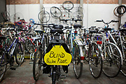 Sign reads 'Blind Pillion Rider'. The hospital cycling scheme at the University Hospital of South Manchester (UHSM) is to encourage staff to cycle to work and reduce their carbon footprint. Staff can borrow bikes or use the workshop facilities for their own bikes. Manchester, United Kingdom.