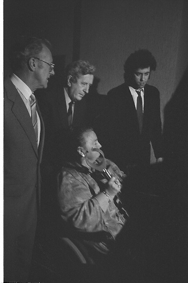 Bob Geldof Receives F.A.O.Medal..1986..16.10.1986..10.16.1986..16th October 1986..The highlight of Gorta's 21st anniversary World Food Day was the presentation of an F.A.O.(Food and Agriculture Organisation of the United Nations) to Bob Geldof. The medal was presented by An Taoiseach,Dr Garret Fitzgerald. The medal was in recognition of Bob's efforts and contribution towards famine relief in the Third World. The ceremony took place in The Berkeley Court Hotel in Dublin...Photograph of An Taoiseach, Dr Garret Fitzgerald, as he wheels his wife into the reception room, the are closely followed by Bob Geldof and Mr Ronald Smylie, Chief Executive of Gorta.