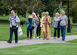 © Licensed to London News Pictures. 09/09/2020. London, UK. A large group of walkers enjoy a stroll around Primrose Hill in North London as Health Minister Matt Hancock announced that from Monday a social gathering of more than six people will be illegal in England and enforced with a £100 fine after a surge of positive Covid19 cases. Earlier Labour Leader Keir Starmer blasted Prime Minister Boris Johnson during PMQs over the handling of the UK's testing program and pointed out that many people weren't able to get a test near their homes and were being told to travel miles to get one. Photo credit: Alex Lentati/LNP
