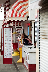 Teenage girl working at MacDonalds Ices a Traditional British seaside fast food stall on the sea front at Cleethorpes Lincolnshire..1 July 2012.Image © Paul David Drabble