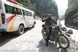 Talk Shop Podcaster Danger Dan riding a Royal Enfield Himalayan in Motorcycle Sherpa's Ride to the Heavens motorcycle adventure in the Himalayas of Nepal. On the third day of riding, we went from Pokhara to Kalopani. Wednesday, November 6, 2019. Photography ©2019 Michael Lichter.