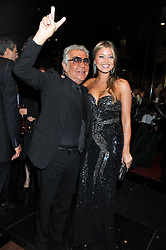 ROBERTO CAVALLI and HOLLY VALANCE at a party hosted by Roberto Cavalli to celebrate his new Boutique's opening at 22 Sloane Street, London followed by a party at Battersea Power Station, London SW8 on 17th September 2011.