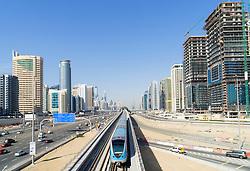 Metro train and skyline of Dubai at Jumeirah Lakes Towers (JLT)  in Dubai United Arab Emirates