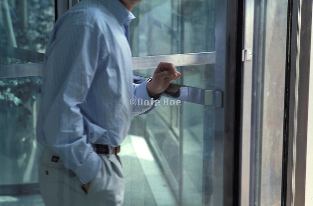 businessman using revolving doors
