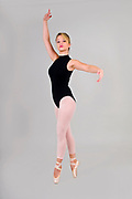 Female blond Ballet Dancer balances on her toes