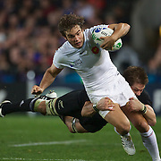 Alexis Palisson, France is tackled by a diving Richie McCaw, New Zealand, during the New Zealand V France Final at the IRB Rugby World Cup tournament, Eden Park, Auckland, New Zealand. 23rd October 2011. Photo Tim Clayton...