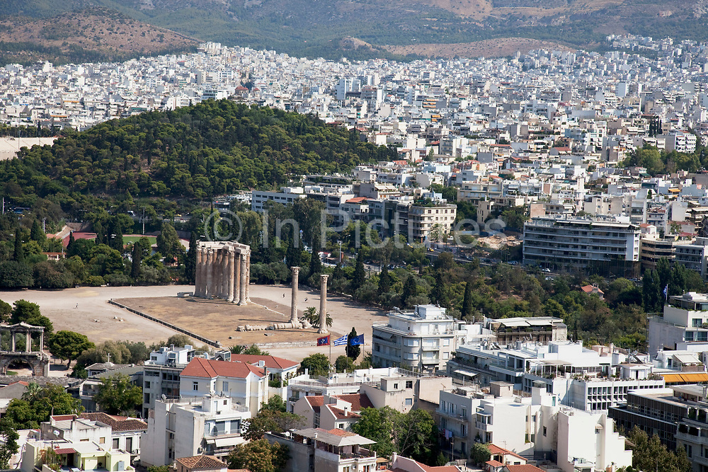 Temple of Olympian Zeus with the areas of Mets and Pangrati behind. The Temple of Olympian Zeus also known as the Olympieion or Columns of the Olympian Zeus, is a colossal ruined temple in the centre of the Greek capital Athens that was dedicated to Zeus, king of the Olympian gods. Construction began in the 6th century BC during the rule of the Athenian tyrants, who envisaged building the greatest temple in the ancient world, but it was not completed until the reign of the Roman Emperor Hadrian in the 2nd century AD some 638 years after the project had begun. During the Roman periods it was renowned as the largest temple in Greece and housed one of the largest cult statues in the ancient world. Athens is the capital and largest city of Greece. It dominates the Attica periphery and is one of the world's oldest cities, as its recorded history spans around 3,400 years. Classical Athens was a powerful city-state. A centre for the arts, learning and philosophy.