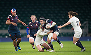 Twickenham, United Kingdom.  Half Back Pairing, [L] Natashe HUNT and [R] Naty MCLEAN, move in to stop, Shannon IZAR's run, during the  Women's RBS.Six Nations : England Women  vs France Women. at the  RFU Stadium, Twickenham, England, <br /> <br /> Saturday  04/02/2017<br /> <br /> [Mandatory Credit; Peter Spurrier/Intersport-images]