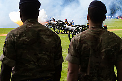 Hyde Park, London, June 10th 2016. As  part of the double celebration of HM The Queen and her Husband HRH Prince Philip, the King's Troop Royal Horse Artillery fire a 41 gun salute in honour of Prince Philip's 95th birthday in London's Hyde Park. PICTURED: Soldiers look on as a gun discharges its thunder.