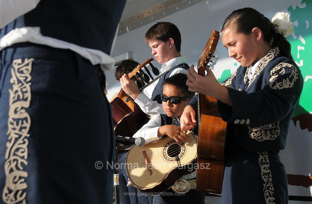 Mariachi Tesoro performs at Dia De San Juan Fiesta at the Santa Cruz River Park, Tucson, Arizona, USA.