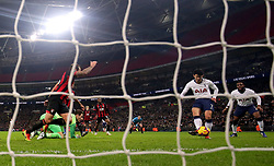 Tottenham Hotspur's Son Heung-min scores his side's fifth goal of the game during the Premier League match at Wembley Stadium, London.