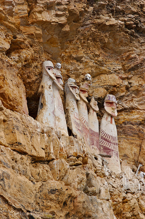 Karajia is a spectacular funerary site. It is located in the district of Lamud, province of Luya, region Amazonas in Peru. South America..Here we will find 2-meter anthropomorphic wooden coffins located under a cliff. Mummies were placed inside each coffin..The Chachapopyas buried their dead in capsule-like tombs constructed of stone, wooden or cane poles and clay. Known locally as purunmachus (from the Quechua, purun wild and machu, old), the funerary statues lookout from cliffside perches overlooking the left bank of the Utcubamba River and several of its western tributaries. The scientific tests made by the investigators, show that the funeral monuments would have been constructed in the year 1460 AD (+/- 60 years)..A French-Peruvian team of archaeologists moreover discovered at least three human skulls inside a cavern in Chaquil, Chachapoyas 08 October, 2006. The discovering would be a proof of human sacrifice practices during the Chachapoyas culture, 800-1470 (AD)