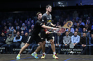 Mathieu Castagnet of France (wearing the black shirt) collides into Joe Lee of England (in the grey shirt). Canary Wharf Squash Classic 2016 , day two at the East Wintergarden in Canary Wharf , London on Tuesday 8th March 2016.<br /> pic by John Patrick Fletcher, Andrew Orchard sports photography.