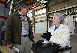 Newly elected  city council member, Bob Sampayan, laughs with Vallejo city council member Joanne Shivley as  Blu Homes opens their West Coast factory on Mare Island in Vallejo, California Dec. 1, 2011.  Over 400 guests attended a ribbon cutting ceremony at the 250,000-square-foot facility.