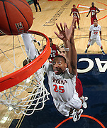 CHARLOTTESVILLE, VA- NOVEMBER 13: Akil Mitchell #25 of the Virginia Cavaliers shoots the ball during the game on November 13, 2011 at the John Paul Jones Arena in Charlottesville, Virginia. Virginia defeated South Carolina State 75-38. (Photo by Andrew Shurtleff/Getty Images) *** Local Caption *** Akil Mitchell