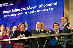© London News Pictures. 12/02/2013 . London, UK. Mayor Of London, BORIS JOHNSON (centre) opening the days trading at the London Stock Exchange with XAVIER ROLET, CEO of London Stock Exchange Group (right).  Photo credit : Ben Cawthra/LNP