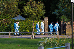 """Police at Tottenham Cemetery, London, where the body of a man was found this morning with several gunshot wounds.  September 3, 2018.  See NATIONAL story NNGRAVE.  A 22-year-old man was found shot dead in a north London graveyard this morning.  The body with several gunshot wounds was found by a member of the public who dialled 999 inside Tottenham Cemetery just before 8am.  The 62-acre cemetery opened at 7.30am and is less than a mile from Tottenham Hotspurs stadium.  A spokesman for Scotland Yard said: """"A murder investigation has been launched in Tottenham after a man was fatally shot in Tottenham Cemetery."""". London, September 03 2018."""