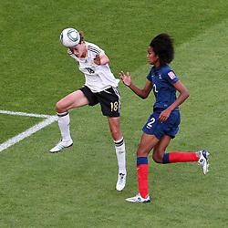 05-07-2011 VOETBAL: FIFA WOMENS WORLDCUP 2011 FRANCE - GERMANY: MONCHENGLADBACH<br /> Kopfball zum 0:1 durch Merstin Garefrekes (GER #18, Frankfurt) (L) gegen Wendie Rennrad (Frankreich) <br /> ***NETHERLANDS ONLY***<br /> ©2011-FRH- NPH/Mueller