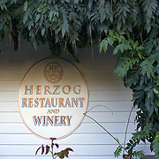 Hans Herzog winery, restaurant and vineyard cottage. Marrlborough, South Island New Zealand.  Hans Herzog's roots lie in Switzerland where the family has grown wine since 1630.  The boutique estate and restaurant is widely acclaimed as one of the best in New Zealand...The Marlborough wine region is New Zealand's largest wine producer. The Marlborough wine region has earned a global reputation for viticultural excellence since the 1970s. It has an enviable international reputation for producing the best Sauvignon Blanc in the world. It also makes very good Chardonnay and Riesling and is fast developing a reputation for high quality Pinot Noir. Of the region's ten thousand hectares of grapes (almost half the national crop) one third are planted in Sauvignon Blanc. Marlborough, New Zealand, 10th February 2011. Photo Tim Clayton