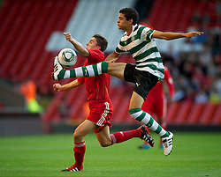 LIVERPOOL, ENGLAND - Wednesday, August 17, 2011: Liverpool's Adam Morgan in action against Sporting Clube de Portugal's Tiago Ilori during the first NextGen Series Group 2 match at Anfield. (Pic by David Rawcliffe/Propaganda)