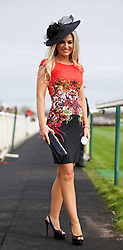 LIVERPOOL, ENGLAND - Friday, April 4, 2014: Andrea Bennett of Crosby wearing a Roberto Cavalli dress and Christian Louboutin shoes during Ladies' Day on Day Two of the Aintree Grand National Festival at Aintree Racecourse. (Pic by David Rawcliffe/Propaganda)