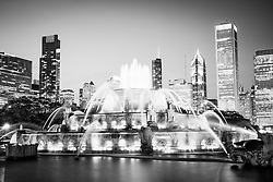 Chicago Buckingham Fountain black and white picture with the Chicago skyine at night. Officially named the Clarence F. Buckingham Memorial Fountain, the fountain is a very popular attraction located in Grant Park in downtown Chicago. High resolution photo is Copyright © 2012 Paul Velgos with All Rights Reserved.