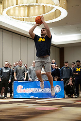 """The Michigan Wolverines participate in the """"Battle for Bowl Week"""" Basketball Challenge on Tuesday, December 25, 2018, in Atlanta. """"Battle for Bowl Week"""" consists of a series of events that each team participates in, with the overall winning team taking home the """"Battle for Bowl Week"""" belt; Michigan will face Florida in the 2018 Chick-fil-A Peach Bowl NCAA football game on December 29, 2018. (Paul Abell via Abell Images for the Chick-fil-A Peach Bowl)"""