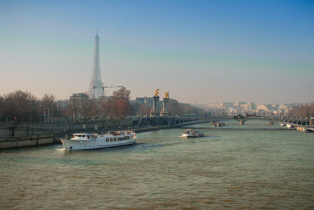 Pont Alexandre III over River Seine, Paris with the Eiffel Tower in background.