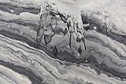 Patterns caused by sediment transport by water in the sand on Horseid Beach, Moskenesoya, Lofoten Islands, Norway.